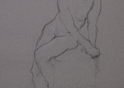 M-J Kelley's figure drawing of female model sitting on pedestal, twisting. Charcoal and pastel on textured grey canson paper.
