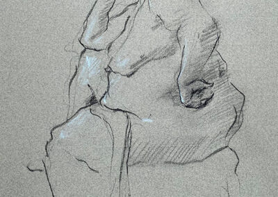 M-J Kelley's drawing of Carla. She is seated and in profile. Charcoal on grey Canson paper with light blue highlights. Drawn in 2004.
