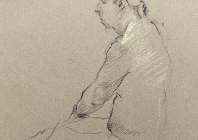 M-J Kelley's drawing of a man seated on the ground with his back turned. Charcoal on tan paper.