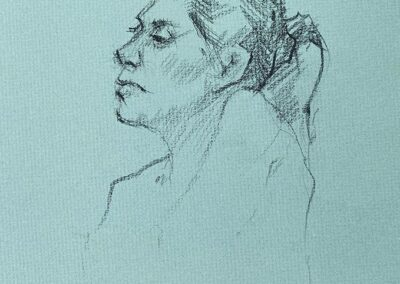 M-J Kelley's drawing of Rebecca. Quick study of her profile. Charcoal on green Canson paper.