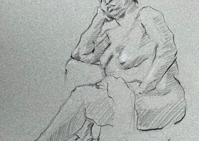M- J Kelley's drawing of a woman seated and leaning on her arm.