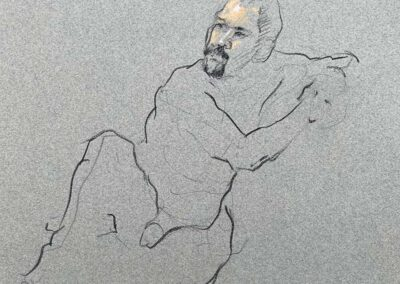 M-J Kelley's drawing of a man seated on the ground. Charcoal and orange paste.
