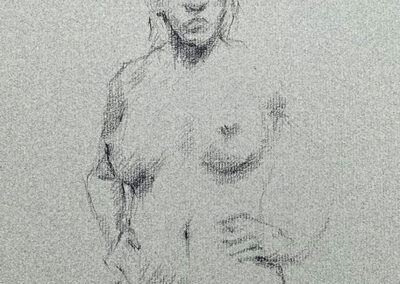 M-J Kelley's drawing of a woman with her hands on her hips. Drawn on light grey Canson paper with Charcoal.