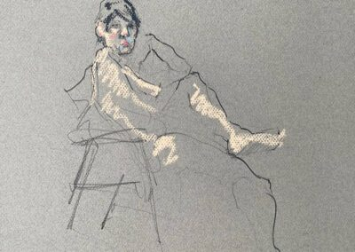 M-J Kelley's drawing of a woman seated. A quick study with charcoal on Canson grey paper. Yellow, blue and rose pastel highlight the figure.
