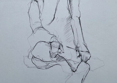 M-J Kelley's drawing of a woman dressed in jeans with leg crossed over left knee. Charcaol on grey paper.